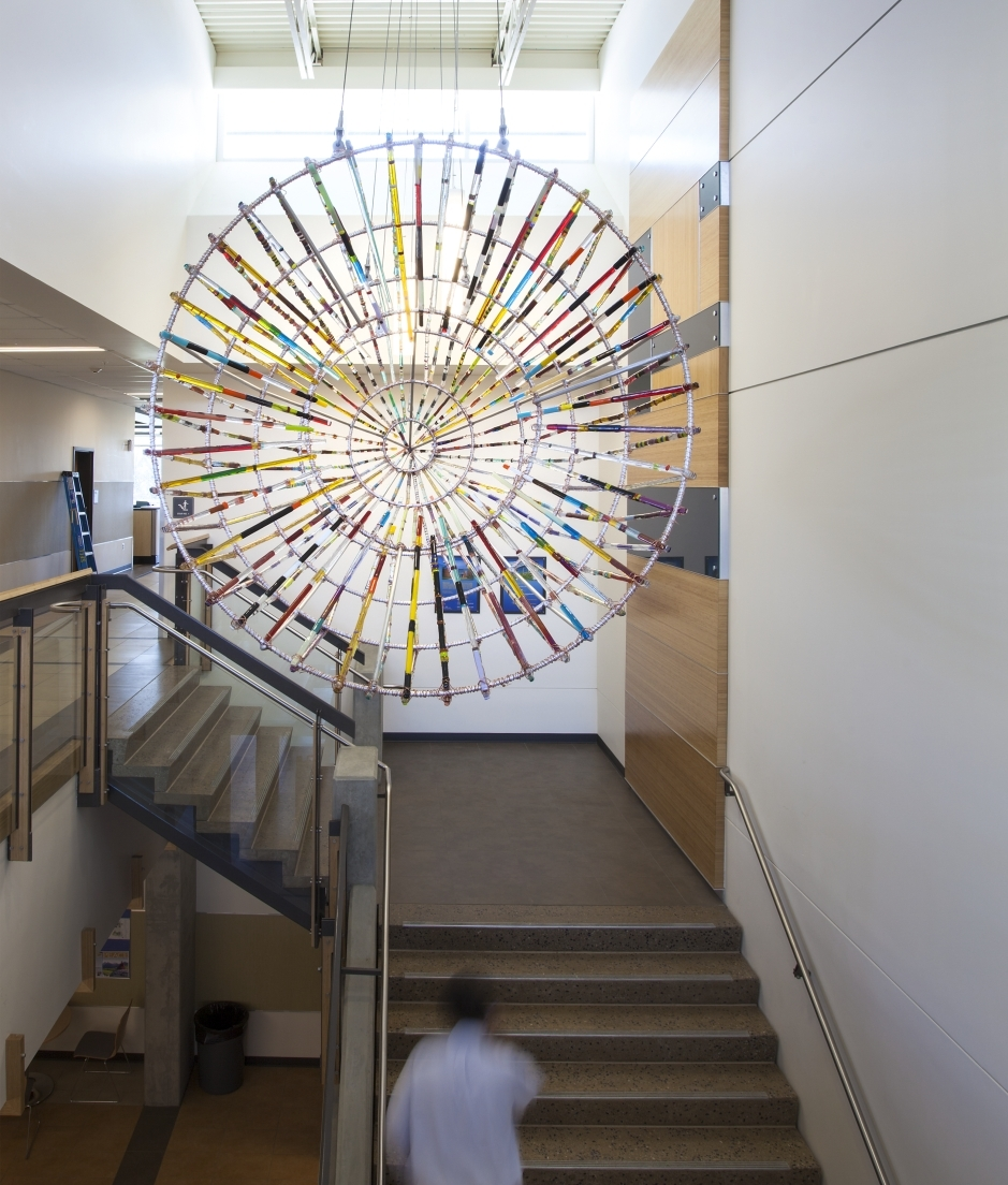 "Joe Feddersen's ""Plateau Fish Trap"" (2015) celebrates the ingenuity and architectural beauty of the Plateau Native fish trap and the historic relationship to the land and fisheries. Installed at Spokane Falls Community College, Spokane. Photo courtesy of the artist, by Joe Nuess. Part of Washington's State Art Collection."