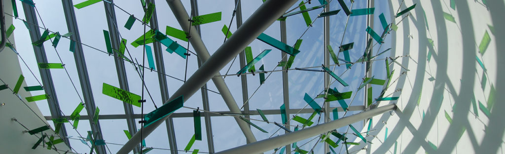 """Artist Jill Anholt's circular skylight """"CLEARING"""" (detail photo, 2015) evokes the memory of the towering old-growth Douglas fir trees that once existed on the Grays Harbor College campus near the Pacific Coast. This artwork is part of Washington's State Art Collection."""