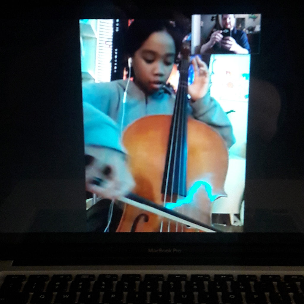 student doing remote learning on cello
