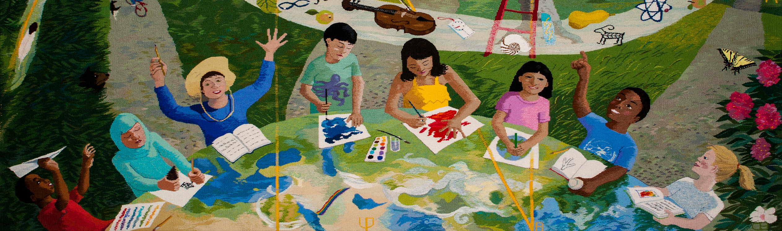 Image of a textile artwork that represents eight children making art at a table. This artwork is part of Washington's State Art Collection.