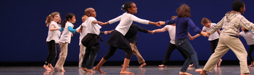 Leschi Elementary students in grades 2 & 3 rehearsing dance onstage at McCaw Hall.
